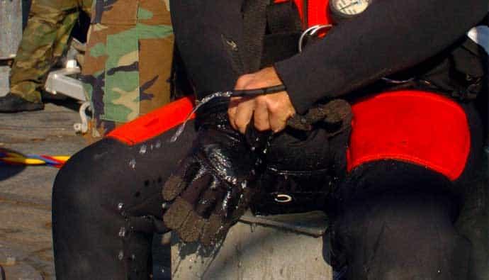 Diver Putting Dive Gloves On