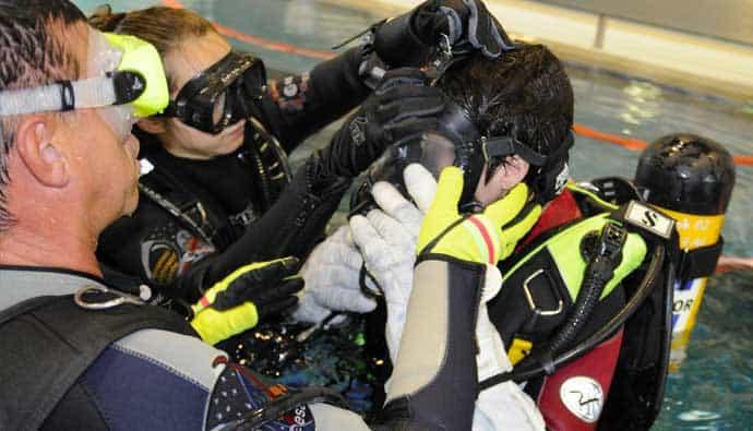 Divers Wearing Gloves Adjusting Mask