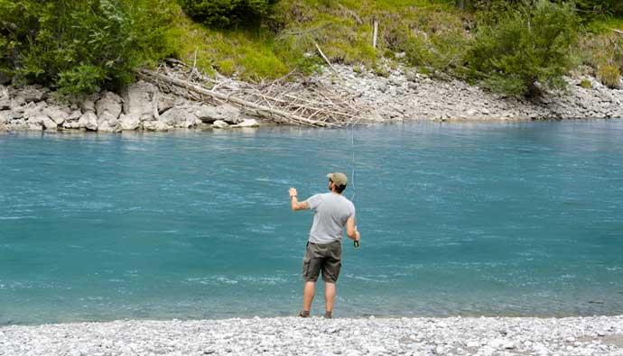 Man fly fishing near river