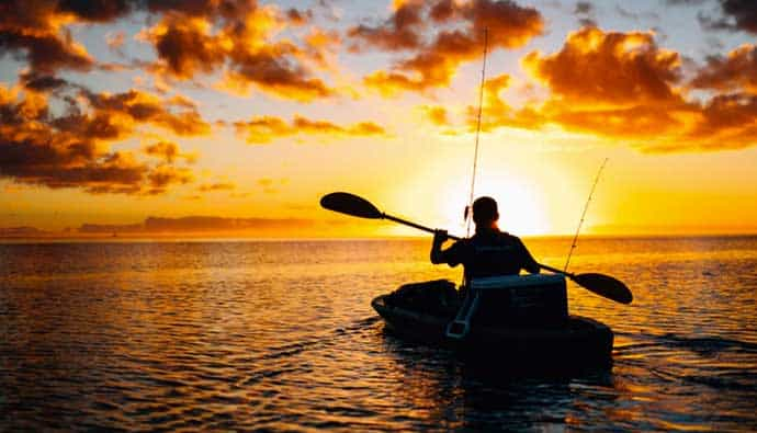 Man Kayak Fishing in the Ocean
