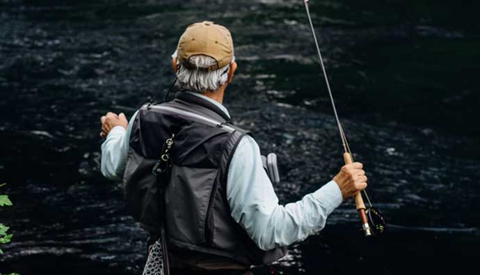 Man In Fly Fishing Waders and Wading Boots
