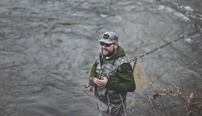 Man Smiling Fly Fishing
