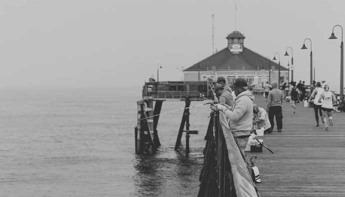 Vintage photo of people pier fishing