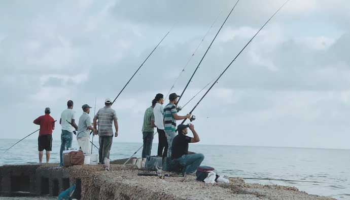 Fishing from a ledge in the ocean