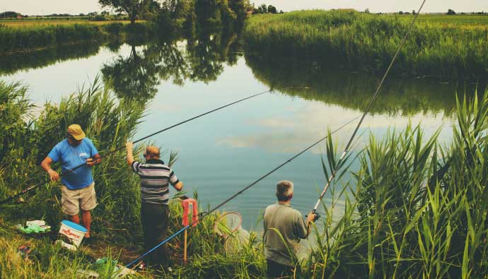 Men fishing at the river