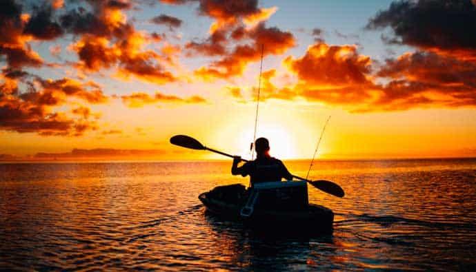 Man kayak fishing in the ocean