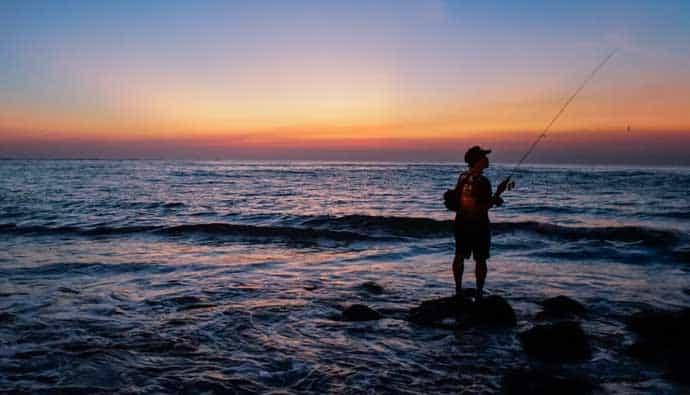 beach fishing man