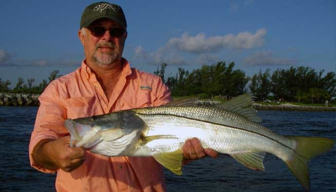 man holding a snook