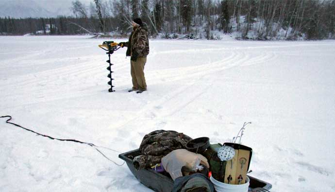 gas auger getting ready to cut through the ice
