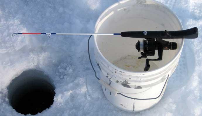 Ice fishing rod on a bucket